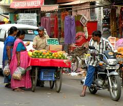 Street vendor (bokage) Tags: street woman india man fruit market delhi vendor paharganj