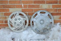 two hubcaps (Justin van Damme) Tags: winter snow cold brick hub grey winnipeg cola coke can cap diet hubcap