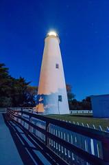 The Ocracoke Lighthouse on Ocracoke Island on the North Carolina coast at night (DigiDreamGrafix.com) Tags: blue lighthouse night warning bay colorful northcarolina safety eveninglight intracoastal shoals ocracokeisland ocracokelighthouse sailorswarning shallowwaters horizontalimage