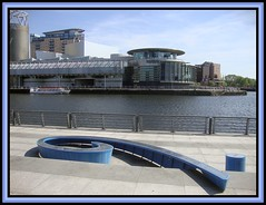 Salford Quays 15 (Margaret Edge the bee girl) Tags: blue sky sun tower water architecture modern buildings landscape manchester outdoors boat salfordquays promenade rails curl