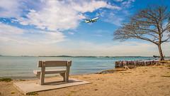 Airplane landing (jh_tan84) Tags: blue sea sky beach water clouds airplane landscape sand nikon landing changi changibeach