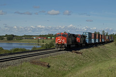 M310 (Trevor Sokolan) Tags: railroad canada cn train rail railway ab trains canadian stack alberta carvel ge railfan trainspotting cnr generalelectric canadiannational intermodal railfanning minklake es44ac edsonsub