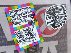 Notated Indian Skull (silverfuture) Tags: streetart chicago colors skull grafitti notes indian stickers feathers note nativeamerican slap picnik dialogue headdress newspaperbox westtown ukranianvillage emore areyouwaitingforgod goodluckwitthatshit thatniggasalwayslate highestreagard areyoumyequal