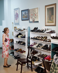 Choices (abe.o) Tags: woman shopping store shoes paintings picture thrift dcist