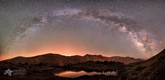 Nighttime Rainbow Over The Rockies (Mike Berenson - Colorado Captures) Tags: sky mountains reflection water