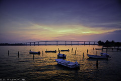 ...and the Sun Slept (K.R. Watson Photography) Tags: bridge sunset sky orange sun color water colors clouds river boats island bay pier row catchy chesapeake patuxent solomons justclouds