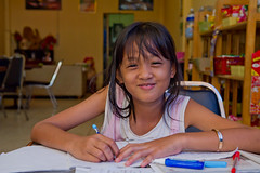 Homework Smile (thai-on) Tags: people girl pen thailand restaurant homework prachinburi totallythailand