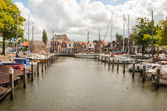 Marina Middelharnis - Jachthaven Middelharnis (RuudMorijn) Tags: old travel houses vacation holiday haven holland travelling history water netherlands dutch sport architecture port marina landscape boot harbor boat vakantie ship yacht jetty traditional transport wolken boten historic explore maritime zomer sail historical aged nautical typical moor picturesque bewolkt oude goeree overflakkee kleurrijk watersport zeilboot middelharnis zuidholland flakkee dorpsgezicht zeilboten jachthaven kaai romantisch sfeervol binnenhaven monumentaal havenhoofd hollandse wolkenlucht meerpalen jachten schilderachtig oudhollandse verstild havenkom rimpelingen zuidhollandse goereeovervlakkee