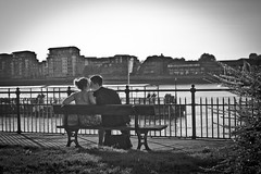 Riverside kiss (jrmsctt) Tags: people woman white man black color colour london thames portraits river view greenwich couples desire olympics canarywharf gmt london2012 expressyourself streetportraiture streettogs