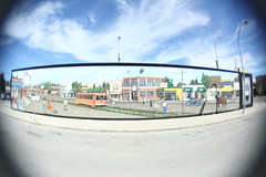 the streets (Maicdlphin) Tags: old streets clouds lomo mural winnipeg good days fisheye portage