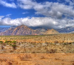 Desert Light (podolux) Tags: 2005 redrockcanyon sky mountains clouds canon october desert lasvegas nevada october2005 roadtrip postprocessing photomatix tonemapped powershota540 photomatixformac