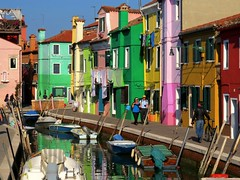 Strolling along the canal, Burano (Marite2007) Tags: venice red people green colors yellow architecture reflections canal colorful colours vibrant vivid happiness multicolored venise venezia venetia burano strolling