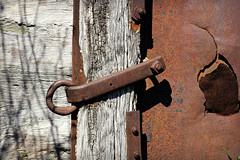 Dominion Seed House Remnant (Doris Burfind) Tags: wood shadow abstract metal rust decay weathered latch relic dominionseedhouse
