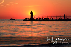 Lake Michigan Sunset (Jeff Meeker) Tags: sunset shadow red vacation orange sunlight reflection yellow canon outdoors gold evening spring midwest colorful shadows artistic michigan vibrant may peaceful lakemichigan adventure explore wonderland canondslr southbeach southhaven coldwater westmichigan 4spring outdoorphotos michiganlighthouses vanburencounty 40degrees southhavenpier southwestmichigan outdoorphotography absolutemichigan southhavenlighthouse outdoorbeauty michiganisamazing outdoorphotographer naturespaintbrush themichigangallery peacefullake allthingsmichigan exploremichigan canon650d puremichigan theworldoutdoors thisisourmichigan photographersofwestmichigan canont4i groupswithexperience michigangottaluvit artisticmichigan