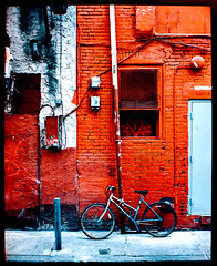 Chinatown Redwall (Kenneth Kohl) Tags: lines sharp full street rule thirds border ektar bike 35mm film red vibrant pushed kodak colorful leica minimalist summicron bright texture rangefinder colors shapes frame analog m7