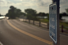 Blue Sign  (Kiev, 1957) (PositiveAboutNegatives) Tags: film sign analog zeiss 50mm florida kodak bokeh rangefinder signage weathered coolscan afternoonlight sonnar jupiter8 gold200 contaxii kiev2a nikon9000scanner johnprincememorialpark freefilmimages freefilmpictures
