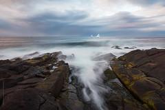 iceberg and waves at Cape Spear, Newfoundland (tuanland) Tags: ocean longexposure sea cloud canada ice rock stone newfoundland evening coast spring nikon shoreline wave iceberg nfld atlanticcanada capespear d600 newfoundlandandlabrador nikond600 stjohns
