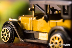 Small rides (Amlan Mathur) Tags: antique automobile beautiful car cool day elegant gold green macro miniature motorsport old outdoor retro small vintage