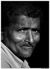 Subtle Smile |  (bmahesh) Tags: portrait people blackandwhite india rural canon village streetphotography streetportrait 100mm chennai mahesh tamilnadu cwc padapai chennaiweekendclickers canon550d canonef100mmf28lmacroisusm bmahesh cwc130