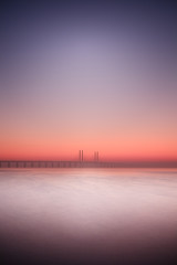 Icy waters (c e d e r) Tags: longexposure bridge sunset seascape color landscape fuji sweden jens le fujifilm bro malm bron afterglow fineartphotography oresund ceder oresundbridge oeresund nd110