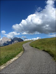 Leading to the sky... (mau_tweety) Tags: road sky italy mountains alps clouds montagne rocks strada italia nuvole meadow cielo rocce alpi prato dolomites dolomiti alpedisiusi trentinoaltoadige coth5