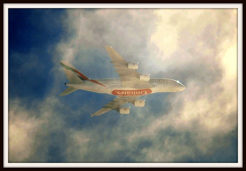 Shot straight into the sun and clouds: UAE147 Emirates Airbus 380 (A6 ...