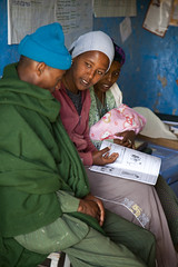 Health Extension Worker discusses Health and Nutrition to a family using the Health Extension Booklet