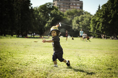 Little boy flying a kite in a park (vlad.marinov) Tags: bulgaria sofia park kite wind street nature portrait childhood freedom green portraitphotography