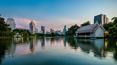 Lumpini Park at Sunset, Bangkok, Thaialnd (tapanuth) Tags: park city light sunset sky urban cloud lake reflection building tree nature water architecture forest landscape thailand evening pond colorful asia cityscape dusk bangkok central southeast siam skyscrapper lumpini