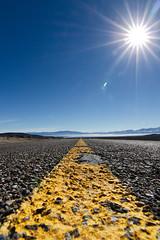 Desert Road (C McCann) Tags: road winter usa sun cold yellow rachel unitedstates desert nevada wideangle roadtrip nv marking desertroad nellis nttr