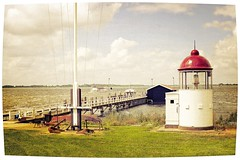 Lighttlehouse (Steve Lundqvist) Tags: sea sky panorama lighthouse holland ferry clouds landscape faro outside pier mare ship quiet open north nederland calm frame marken olanda