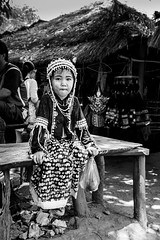 A Padaung Girl (Anoop Negi) Tags: padaung girl sweet finery dress commercial tourism dollars karen tribe tribal chiangmail thailand asia portrait bnw monochrome black white anoopnegi ezee123