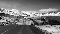 a place where riding a snow plough is quite a joy to be had (lunaryuna) Tags: road winter light bw panorama snow mountains monochrome landscape coast blackwhite iceland spring solitude fjord isolation lunaryuna snowplough mountainrange longandwindingroad northiceland seasonalchange jobstolove lightmood northfjords