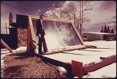 John Keyes, president of International Solarthermics Corporation, shown with the backyard solar heating system he developed..., 05/1975.