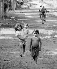 children of hope ..... (ana_lee_smith_in_nicaragua) Tags: poverty road charity travel family school light shadow portrait bw bike sepia children photography hope calle education child photojournalism happiness siblings granada learning barefeet nicaragua santaana organization barrio means literacy nonprofit thirdworld empowerment selfesteem developingnation childrenatrisk hopeforthefuture childrenofhope villageofhope empowermentinternational childofhope villaesperanza analeesmith kathyaadams empowermentthrougheducation photosofnicaragua analeesmithincuba photosofgranada analeesmithinnicaragua