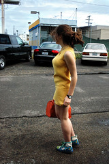 (Madeline K.) Tags: orange color girl car yellow turn parkinglot watch run bowlingalley