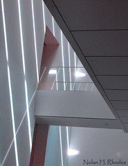 Light Beams Falling And Reflecting Diagonally Down A Wall (nrhodesphotos(the_eye_of_the_moment)) Tags: light geometric glass lines metal floors dark shadows interior shapes moma shades pastels rays walls railing railings beams ceilings lightbeams greys rectangles diagonals wow1 slants nrhodesphotosyahoocom wwwflickrcomphotostheeyeofthemoment flickrstruereflection1 flickrstruereflection2 dsc7776nhr