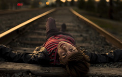 Feel It All Around (Jack Wannemacher) Tags: wood boy sunset red sun black leather oregon train canon bokeh traintracks tracks t3 18 ashland striped gravel
