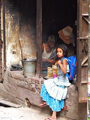 Buying cookies (Zudzowne) Tags: blue girl dress olympus bakery dhaka bangladesh e30 olddhaka zudzowne patrickbeintema