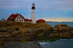 Evening at Portland Head Lighthouse - in explore, front page (SunnyDazzled) Tags: ocean longexposure light sunset sea lighthouse seascape history tourism beach nature station rock stone portland scenery glow head maine cliffs coastal shore