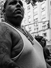 D7K 1366 ep (Eric.Parker) Tags: street city nyc blackandwhite bw ny newyork man monochrome tattoo africanamerican wifebeater 2012 puertoricoparade