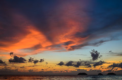 Vivid Clouds (Brian Hammonds) Tags: ocean travel sunset red sea orange color tourism water clouds asian thailand island photography photo seaside nikon rocks asia purple sundown post natural bright dusk south sightseeing smooth vivid tourist pole east adventure photograph thai tropical traveling southeast traveler d7000