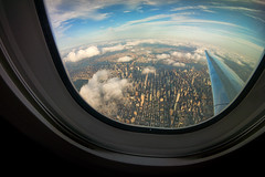 Because the world is round, it turns me on. (Linh H. Nguyen) Tags: world city sunset sky newyork colors architecture clouds buildings airplane flying manhattan sony flight landmarks fisheye round cinematic viewfromabove samyang nex7 8mm28