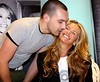 ELLE MACPHERSON being kissed by a fan at the Brown Thomas store to launch the 'Fashion Targets Breast Cancer in Ireland' campaign Dublin, Ireland