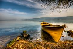 A yellow boat (Nejdet Duzen) Tags: travel cloud lake tree yellow turkey boat trkiye sandal bursa bulut sar aa gl turkei seyahat glyaz ulubatgl ulubatlake mygearandme