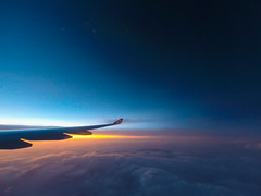 Wing of the plane with cloudy sky on background at sunrise (Evgeny Ermakov) Tags: above travel blue vacation sky cloud tourism nature beautiful beauty clouds speed sunrise airplane observation landscape freedom fly flying high view cloudy outdoor aircraft altitude air horizon transport flight atmosphere landmark scene transportation airline destination midair cloudscape aerospace
