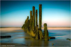 _____\ /_____ (Kevin HARWIN) Tags: wood old uk sunset sea england sky blur beach water canon eos bay sand rocks britain stones south sigma east minnis 550d birchingtononsea