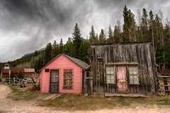 Pink and brown buildings in St. Elmo (Vironevaeh) Tags: sky west history weather clouds outdoors colorado rustic 1800s mining alpine ghosttown photomerge dramaticsky hdr highdynamicrange americanwest stelmo highaltitude miningtown theamericanwest mountainous thewest saintelmo chalkcreek stelmocolorado historicminingtown historiccolorado historicwest
