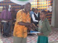 "Dr. Samuel Acquah, lecturer of the Ghana Medical School, Legon presenting an award to one of the pupils • <a style=""font-size:0.8em;"" href=""http://www.flickr.com/photos/48668870@N02/6947270294/"" target=""_blank"">View on Flickr</a>"