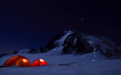 Alpine Start (Ulrik Hasemann) Tags: light mountain snow france mountains alps night start canon stars lights tents altitude august tent adventure explore climbing alpine nightlight chamonix blanc 2009 frankrig headlamps tacul